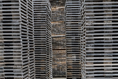 Decayed piles of wooden planks stacked