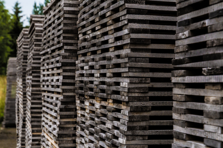 Pile of decayed lumber stacked on top each other