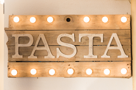 Pasta sign made of wooden planks and light bulbs on top and bottom Stock Photo - 87636771