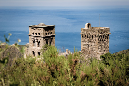 Bushes on the foreground and monastery of Sant Pere de Rodes in back Editorial
