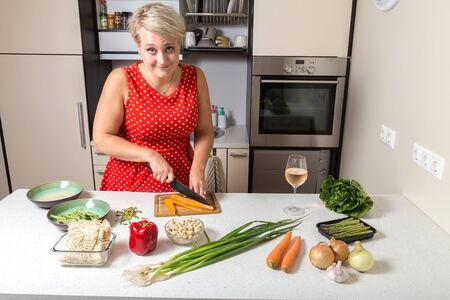 Girl smiling at camera and preparing food