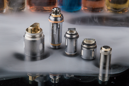 Electronic cigarette Clearomizer coils in smoke cloud