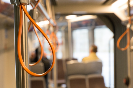 Orange hand holder in tram Stock Photo - 87636806