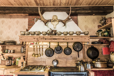 Rustic style kitchen with pots and pans Stock Photo - 87636810