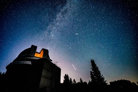 Milky way galaxy over observatory