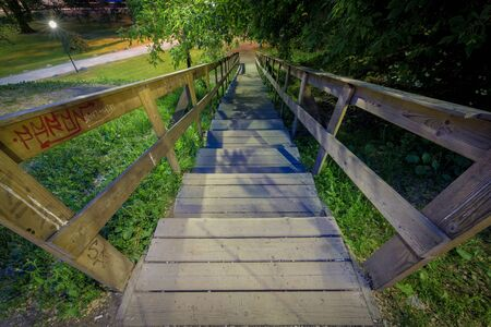 Wooden stairway leading down Stock Photo