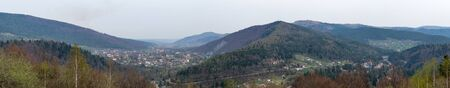 Mountain village in the valley. Panoramic view of Yaremche resort city in Carpathian Mountains, Ukraine.