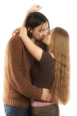 Young adults, lovely kissing each other. Both have long hair ;) Stock Photo - 783868