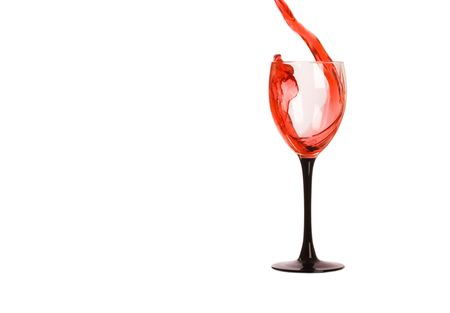Red wine pouring into wine glass, isolated on white photo