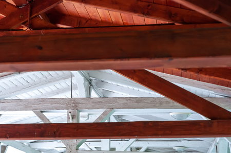 Closeup interior view of a wooden roof structure.