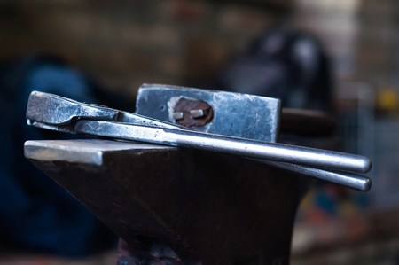 Metal tools and equipments of the blacksmith for horse shoeing in the barn.