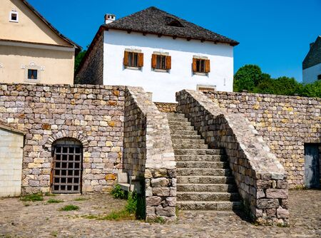 View on the stairs and the traditional hungarian pise houses on a sunny day in Szentendre, Hungary on a sunny day. Stock Photo