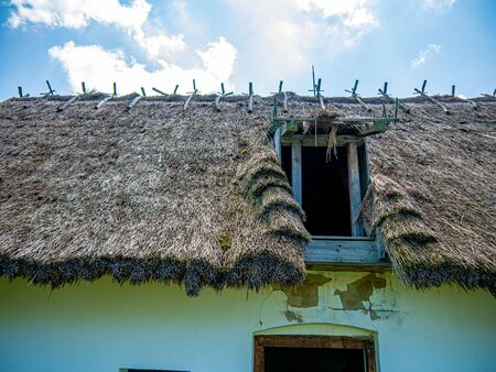View on the tatched roof of a traditional hungarian pise house in Szentendre, Hungary on a sunny day. Stock Photo