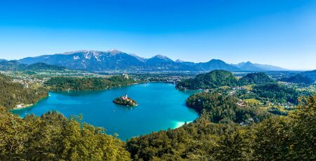 Aerial panoramic view on the Pilgrimage Church of the Assumption of Maria on the Lake Bled on a sunny autumn day.
