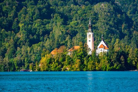 View on the Pilgrimage Church of the Assumption of Maria on the Lake Bled on a sunny autumn day.
