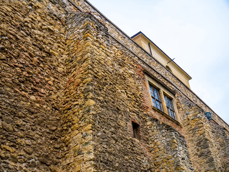 View on the details of the old historic castle Thury castle in Varpalota, Hungary, Europe on a cloudy day.