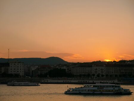 BUDAPEST, HUNGARY - AUGUST 20, 2019: View on the Danube river during sunset in Budapest, Hungary, on the official state holiday of Hungary before the fireworks.