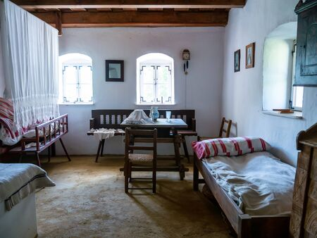 SZENTENDRE, HUNGARY - JUNE 8, 2019: View on a room of a traditional hungarian pise house in the Skanzen of Szentendre, Hungary, Europe on sunny day.
