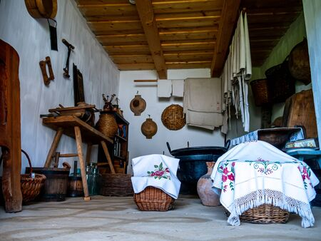 SZENTENDRE, HUNGARY - JUNE 8, 2019: View on a traditional pantry of a pise house in the Skanzen of Szentendre, Hungary, Europe on sunny day.