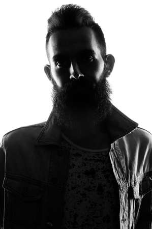 Fashion portrait of a bearded man wearing in a studio environment in front of a white background. Banque d'images