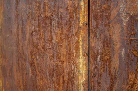 Texture of an extremely rusty metal door.