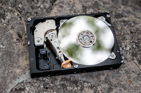 View on a hard disk drive on a concrete surface on a sunny day.