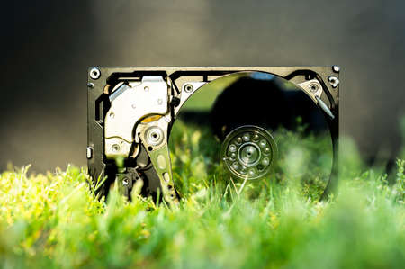 View on a hard disk drive on the grass on a sunny day. Banque d'images