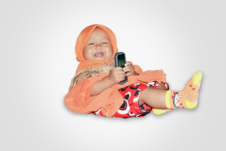 doctor s smock: Little girl veiled and play mobile phone