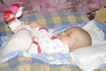 The little girl again cool in her bed photo
