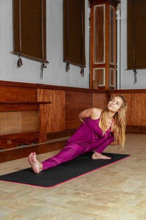 Female sport women workout exercise. Yoga girl doing stretching exercises. Imagens