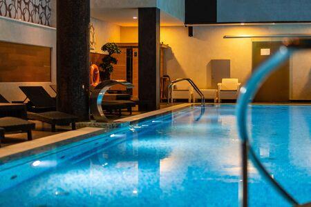 Modern blue on light backdrop. Water - swimming pool. Trendy design.