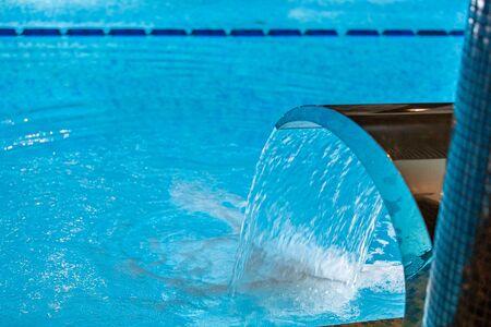Interior swimming pool in luxury hotel spa center Фото со стока