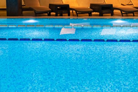 Swimming pool for luxury lifestyle design. Water - swimming pool. Luxury lifestyle. Natural pattern, luxury. Blue background. Water sports. Water - swimming pool. Stok Fotoğraf