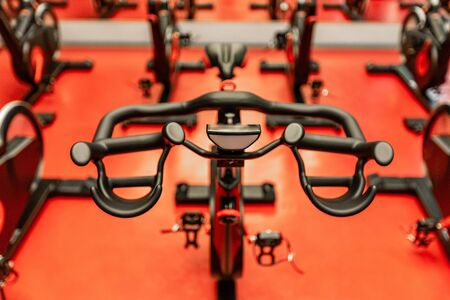 Stationary Spinning bicycles. Spinning class with empty bikes