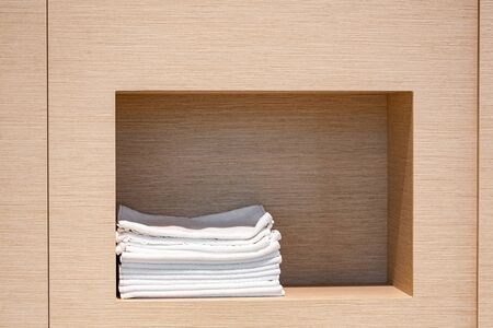 cupboard towels. wood texture background. Body care hygiene.