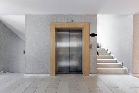 Modern steel elevator. Stairs, interior, office. perspective wide angle.