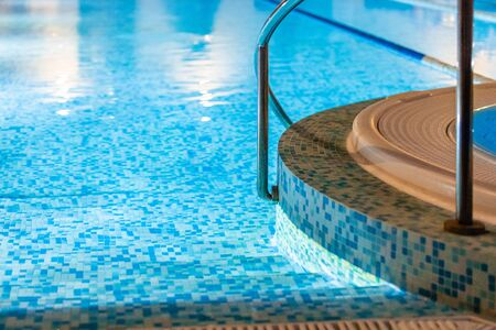 Swimming pool for luxury lifestyle design. Water - swimming pool. Luxury lifestyle. Natural pattern, luxury. Blue background. Water sports. Water - swimming pool. Фото со стока