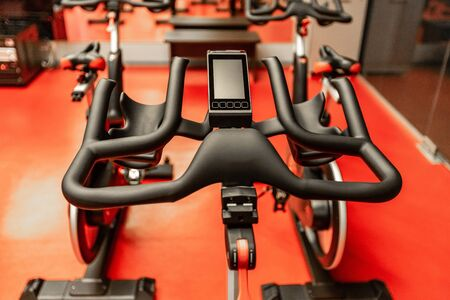 Stationary Spinning bicycles. Spinning class with empty bikes Stok Fotoğraf - 142500345