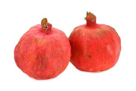 Two pomegranates isolated on white background