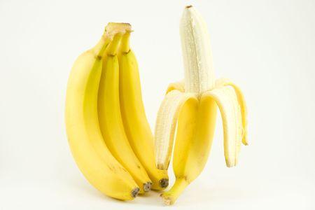 Four bananas on light background Stock Photo
