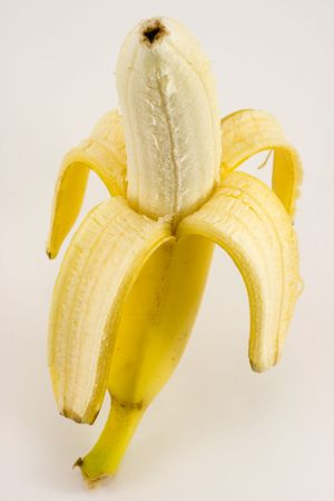 One banana on light background