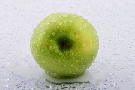 Waterdrops on green apple Stock Photo - 4852955