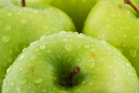 Waterdrops on green apple Stock Photo