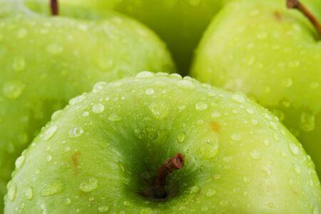 Waterdrops on green apple Stock Photo