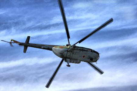 Military helicopter in sky Stock Photo
