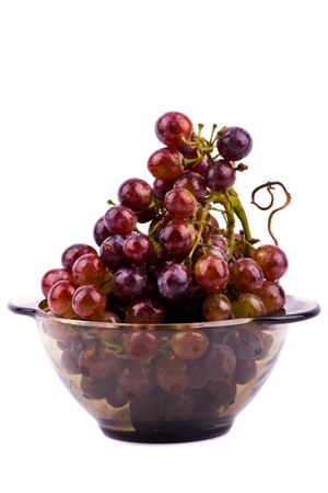 Grapes in bowl isolated on white background