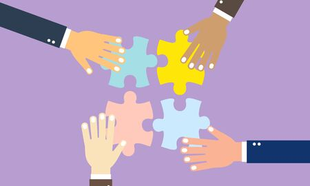 Business team with pieces of puzzle in office
