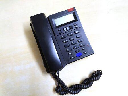 Black old landline isolated on gray background Фото со стока
