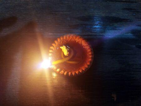 Traditional clay diya lamps lit during diwali celebration Zdjęcie Seryjne - 133359861