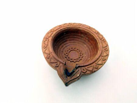 Traditional clay diya lamps lit during diwali celebration Zdjęcie Seryjne - 133359890